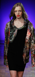 Anne Valerie Hash catwalk picture with black short dress with colorful shirt.PNG