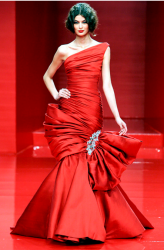 Glamous red gown by Georges Hobeika fashioin designer.PNG