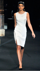 Hussein Chalayan 2010 collection for Spring with white short dress.PNG