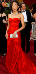 Actress wearing Michael Kors' bright red gown.PNG