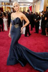 Rita Ora in Marchesa couture and Lorraine Schwartz earrings at the 87th Oscars red carpet.JPG