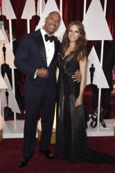 Dwayne Johnson on red carpet 2015 with his wife, Lauren Hashian  at the 87th Annual Academy Awards.JPG